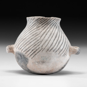 An Anasazi Black-on-White Canteen, 6-1/4 x 9-1/4 in.