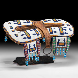 Plains Cree Beaded Hide Pad Saddle, From the Collection of Charles and Valerie Diker