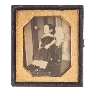 Striking Postmortem Daguerreotype of a Young Girl in a Chair with Flowers