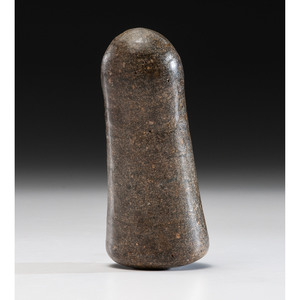 A Highly Polished Granite Pestle, 7 in.