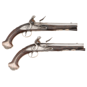 Pair of Silver Mounted Early English Flintlock Pistols by Barbar