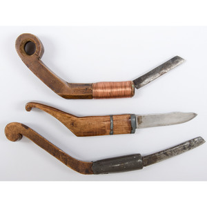 Crooked Knives with Carved Decorations and Inlay