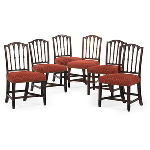 A Set of Six New York Federal Carved Mahogany Dining Chairs