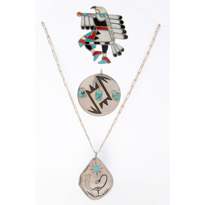 A Collection of Zuni, Navajo, Hopi, and Southwestern Pendants and Charms