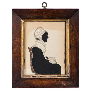 Hollow Cut Silhouette of a Woman with Book