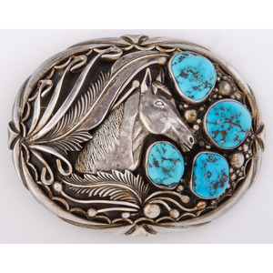 R.L. Guerro (Dine, 20th century) Navajo Silver and Turquoise Belt Buckle, with Horse Heads