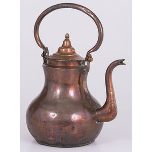 A Dutch Hammered Copper Kettle