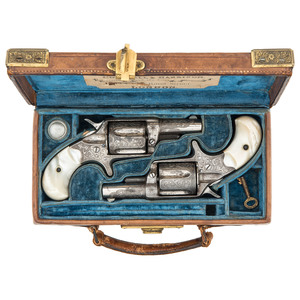 Very Fine Matched Pair of Factory Engraved Colt New Line 38's in Spectacular Engraved Brass Bound Cogswell & Harrison Leather Case