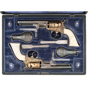 Elaborate Exhibition French Cased Gilt and Silver Engraved Cooper Double-Action Pocket Percussion Revolvers With Magnificent High Relief Carved Eagle with Shield One Piece Ivory Grips