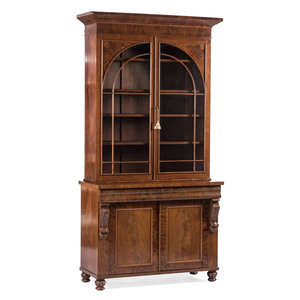 A Federal Carved and Figured Mahogany Bookcase Hutch
