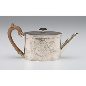 George III Sterling Teapot with Engraved Decoration