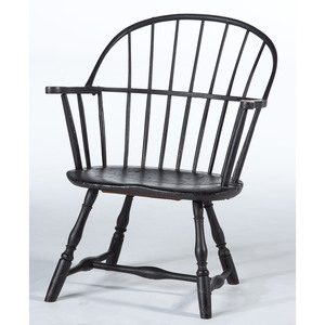 A Carved, Turned and Black-Painted Sack-Back Windsor Armchair