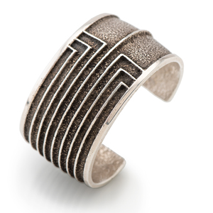 Robert Sorrell (Dine, 20th century) Sterling Silver Tufa Cast Cuff Bracelet, with Coral