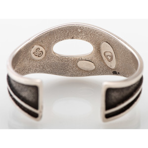 Robert Sorrell (Dine, 20th century) Sterling Silver Tufa Cast Cuff Bracelet, with 14k Gold Accent