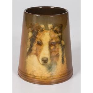 A Rookwood Pottery Standard Glaze Collie Mug by E.T. Hurley