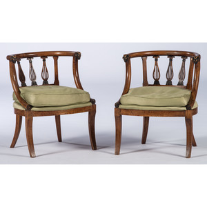 A Pair of Continental Armchairs with Rams Head Terminals