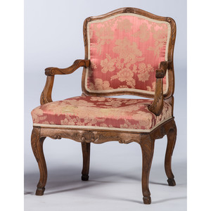 A Continental Fruitwood Fauteuil with Spanish Feet
