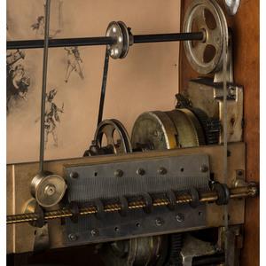 A Regina Corona Floor Model 27-Inch Disc Changer Music Cabinet