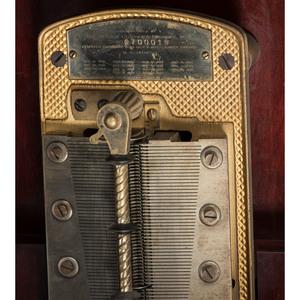 A Regina Upright 15 1/2-inch Disc Music Player