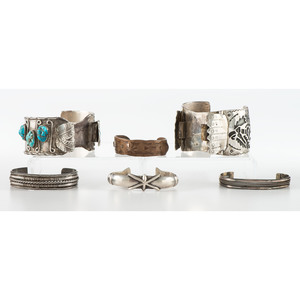 A Group of Silver and Copper Cuff Bracelets and Watch Bands