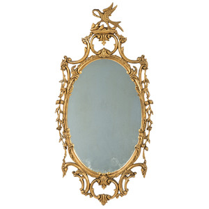 A Giltwood Oval Looking Glass