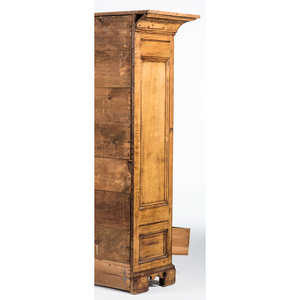 A New York Queen Anne Carved and Molded Red Spruce Kast