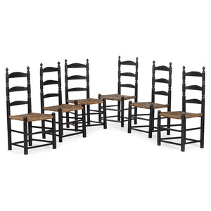A Set of Six William and Mary Style Black-Painted Rush Seat Ladder-Back Side Chairs