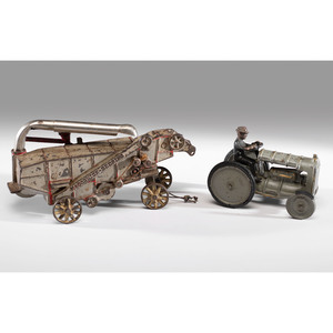 An Arcade Cast Iron McCormick Derring Thresher and Fordson Tractor