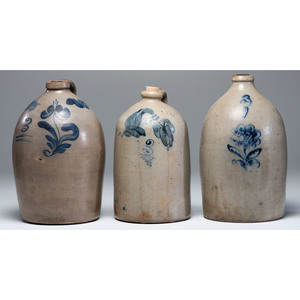 Three Stoneware Jugs with Cobalt Flower Decoration