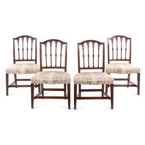 A Set of Four Federal Carved Mahogany Dining Chairs
