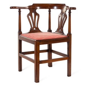 A Chippendale Carved Mahogany Roundabout Corner Chair