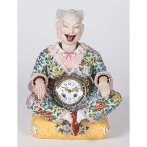 A Porcelain Nodder Chinese Figure with Clock, in the Meissen Style