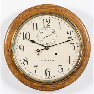 A Seth Thomas Thirty Day Brass and Oak Gallery Clock