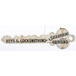 A Painted Wood Figural Locksmith's Trade Sign