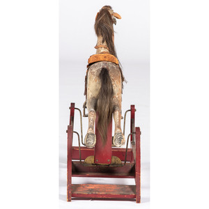 A Whitney Reed Co. Painted Wooden Rocking Horse