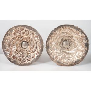 A Pair of Loring Andrews Repoussé Castle Pattern Silver Candlesticks