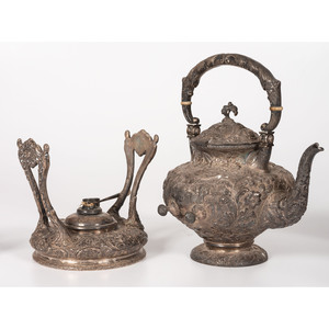 A Loring Andrews Repoussé Castle Pattern Silver Coffee and Tea Service