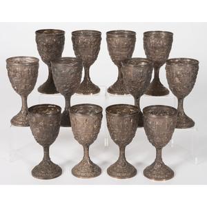 A Set of Twelve Loring Andrews Repoussé Castle Pattern Goblets
