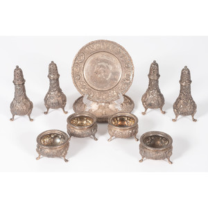 A Group of Loring Andrews Repoussé Castle Pattern Shakers, Salts and Plates