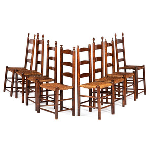 An Assembled Group of Eight Rush Seated Ladder Back Side Chairs