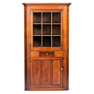 A Paneled Walnut Corner Cupboard