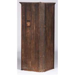A Paneled Walnut Corner Cupboard