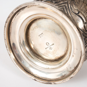 A Silver Vase with Dolphin Handles by Tuttle