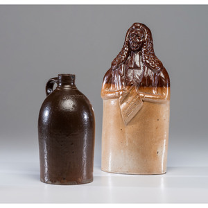 An English Figural Flask and Redware Jug
