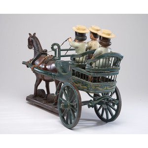A Folk Art Carving of a Horse-Drawn Buggy with Three Figures