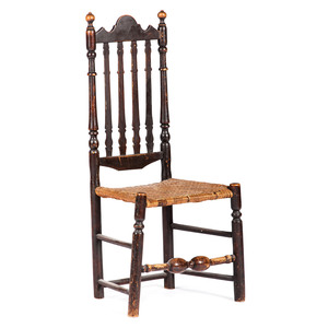 A William and Mary Brown-Painted Bannister Back Cane-Seat Side Chair