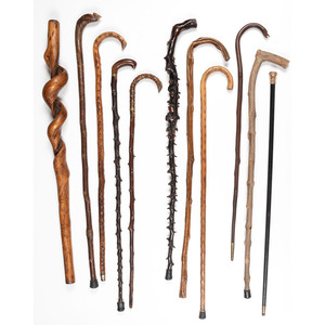 A Group of Carved Wooden Canes and Walking Sticks