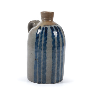 An Unusual Pennsylvania Half Gallon Stoneware Jug With Vertical Cobalt Stripes