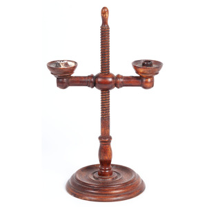An Adjustable Turned Maple Double Candlestick