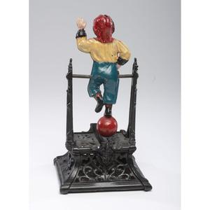 A Boy on Trapeze Cast Iron Mechanical Bank